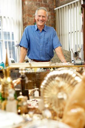Male antique shop proprietor