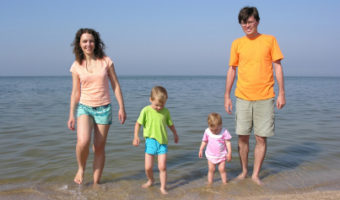 family of four on beach