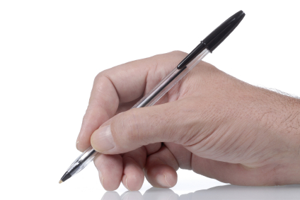 Ordinary black ballpoint pen in male hand