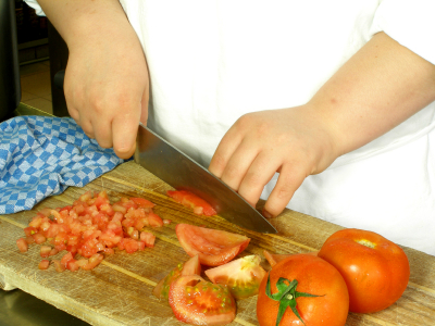Chef is dicing tomatoes