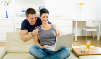 Young couple purchasing on internet