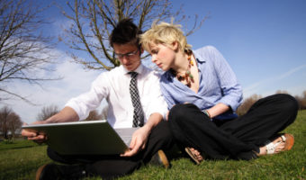 couple laptop outdoors